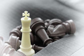Close up of chess figure on suit background strategy or leadersh — Foto de Stock