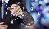 Businessman hand showing human icon flow chart on new modern com — Stockfoto
