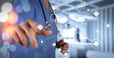 Smart medical doctor hand showing network with bokeh exposure as — Stock Photo