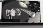 Big data concept-miniature engineer working with drafting table  — Stock Photo