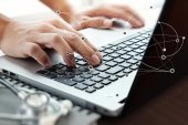 Close up of Doctor hand using laptop computer in office — Stock Photo
