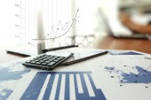 Business documents on office table with calculator and digital t — Stock Photo