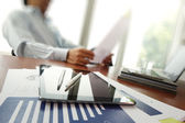 Business documents on office table with smart phone and digital — Stock Photo