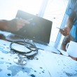 Team doctor working with laptop computer in medical workspace of — Stock Photo #77514318