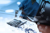 Doctor working with digital tablet and laptop computer in medica — Stock Photo