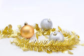 Chirstmas 's ball with golden ribbon for celebration and festiva — Stock Photo