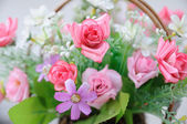 Beautiful flowers in basket — Stock Photo