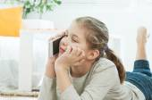 Beautiful teenager in the living room — Stock Photo