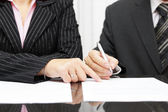 Business woman  show a businessman  to sign a agreement — Stock Photo