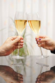 Man and woman celebrating with wine — Stock Photo