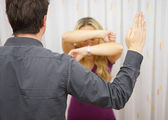 Husband wants to  harm his wife with slapping, domestic violence — Stock Photo