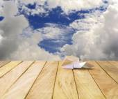 Paper airplane on a wooden platform. — Stock Photo