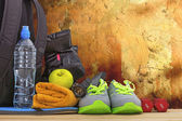 Sports equipment against the wall — Stock Photo