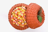 Pumpkin Basket Full Of Candy Corn — Stock Photo