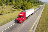 Big Red Truck Speeding Down Highway — Stock Photo