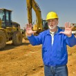 Foreman Directing Traffic On Construction Site — Stock Photo #55686257