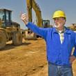 Foreman Directing Traffic On Construction Site — Stock Photo #55686259