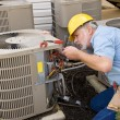 Repairman Works On Apartment Air Conditioning Unit — Stock Photo #55686487