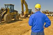Foreman Keeping Watch At Construction Site — Stock Photo