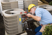 Repairman Works On Apartment Air Conditioning Unit — Stock Photo