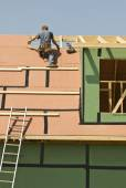 Hard Working Roofer Measures For New Panel — Stock Photo