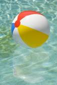 Beach Ball Floating In Swimming Pool Vertical — Stock Photo