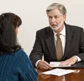 Business Professional Advises Client — Stock Photo