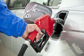 Hand Pumping Gas With Red Fuel Pump — Stock Photo