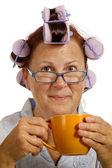 Woman With Curlers Drinking Coffee In The Morning — Stock Photo