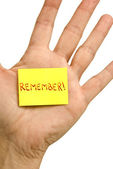 Little 'Remember' Note Stuck To Hand — Stock Photo