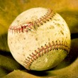 Old Vintage Baseball On Old Fabric — Stock Photo #62796607