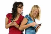 Pretty Young Women Sharing Text Messages — Stock Photo