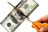 Concept Of Cutting Costs Scissors Cutting Money — Stockfoto
