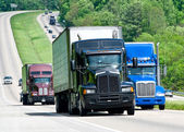 Big Trucks Moving Down A Long Highway — Stock Photo