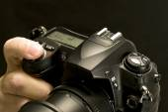Finger Depressing Shutter Button On Digital Camera — Stock Photo
