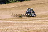 Farmer With Tractor Seeding Field For Summer Crops — Stock Photo