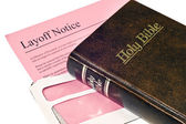 Pink Slip Or Layoff Notice With Bible — Stock Photo