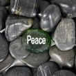 Peace Encouragement Stone In Center Of Smooth Stones — Stock Photo #68791051