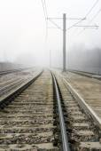Train Tracks Disappearing Into Fog Concept — Стоковое фото