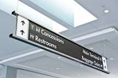 Airport Sign With Information And Baggage Claim At Airport Terminal — Stock Photo