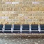 Row Of Empty Seats Against A Brick Wall — Stock Photo #71120731