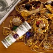 Hundred Dollar Bill NOT REAL Inside A Gold Ring With Cash And Gold Jewelry — Stock Photo #71945005