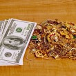 Cash(Fictitious) With Pile Of Gold Jewelry On Counter — Stock Photo #71945031