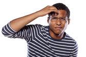 Confused dark-skinned man — Stock Photo