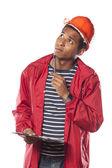 Trabajador con casco y Bloc de notas — Foto de Stock