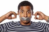 Closed ears and tape over mouth — Stock Photo