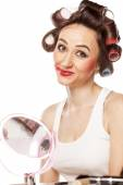Woman with curlers and smeared makeup — Stock Photo