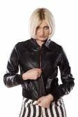 Blonde in leather jacket — Stock Photo