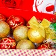 Decoration for Christmas tree, shiny balls with bows — Stock Photo #70615163