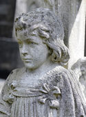 Old statue on grave — Stock Photo